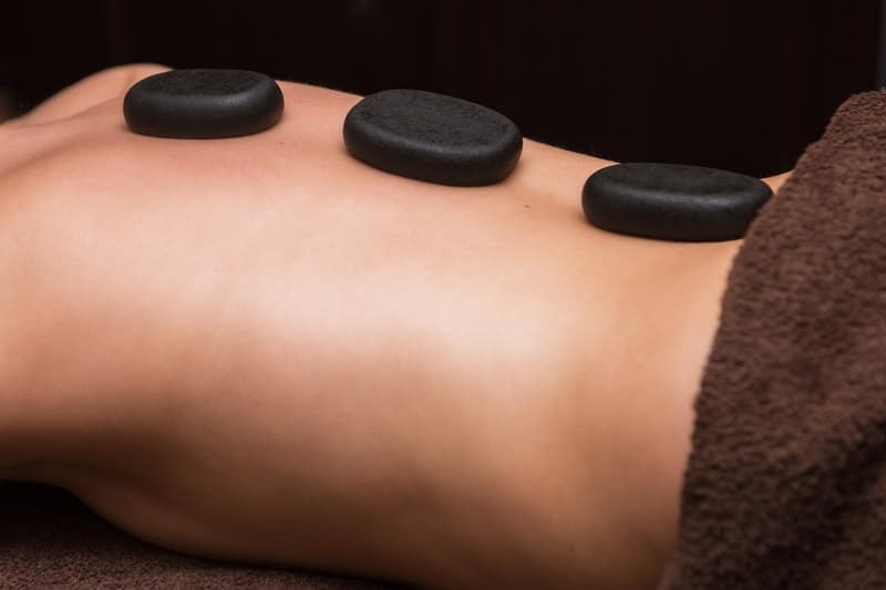 Using stone massage therapy